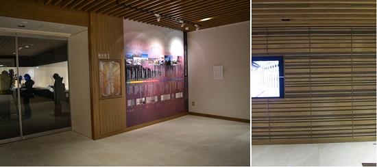 ロビーのプロローグ展示(写真提供:日刊建設通信新聞社)、壁面は県産木材のストライプ模様